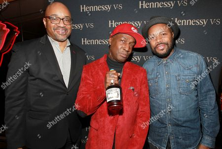 "Rodney Williams, Chief Marketing Officer & Executive Vice President, Moet Hennessy, left, with DJ D-Nice right, presents Grandmaster Flash center, with an engraved Hennessy V.S Limited Edition bottle, created specifically to commemorate the 50th anniversary of Barbados Independence at Sammy's Fish Box on in the Bronx a Borough of New York. Hennessy continues to champion artists, such as Grandmaster Flash, who ""Never stop. Never settle."" and show an uncompromising will to succeed while pushing the boundaries of their potential"