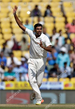 Stock Image of India's Ravichandran Ashwin appeals for a wicket of Sri Lankan batsman during the fourth day of their second test cricket match in Nagpur, India, . Ashwin surpassed Dennis Lillee to become the fastest bowler to capture 300 test wickets when he helped India thrash Sri Lanka by an innings and 239 runs to win the second test in Nagpur on Monday