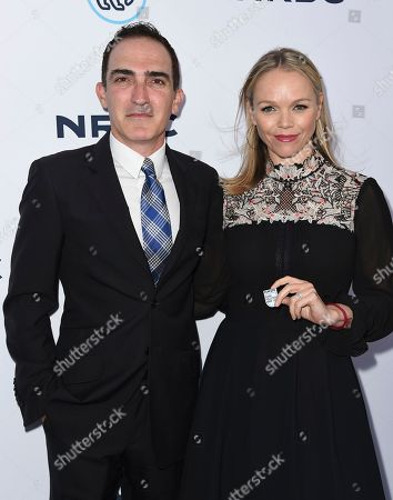 "Patrick Fischler, left, and Lauren Bowles arrive at the ""STAND UP! for the Planet"" benefit at the Wallis Annenberg Center for the Performing Arts, in Beverly Hills, Calif"