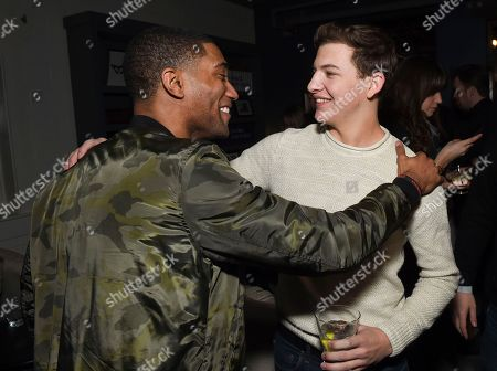 """Actors Carter Redwood, left, and Tye Sheridan greet each other at """"The Yellow Birds"""" cast party hosted by Chase Sapphire on in Park City, Utah"""