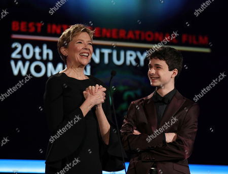 Annette Bening, left, and Lucas Jade Zumann present the award for Best Intergenerational Film at AARP's 16th Annual Movies for Grownups Awards at the Beverly Wilshire Hotel, in Beverly Hills, Calif