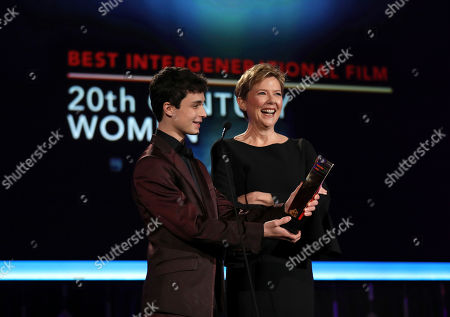 Annette Bening, right, and Lucas Jade Zumann present the award for Best Intergenerational Film at AARP's 16th Annual Movies for Grownups Awards at the Beverly Wilshire Hotel, in Beverly Hills, Calif