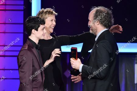 Annette Benning and Lucas Jade Zumann present an award to Mike Mills, right, at AARP's 16th Annual Movies for Grownups Awards at the Beverly Wilshire Hotel on in Beverly Hills, California