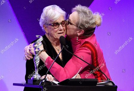 Presenter Ann Roth, left, gets a kiss from Meryl Streep after she gave Streep the Distinguished Collaborator Award during the 19th Annual Costume Designers Guild Awards, in Beverly Hills, Calif