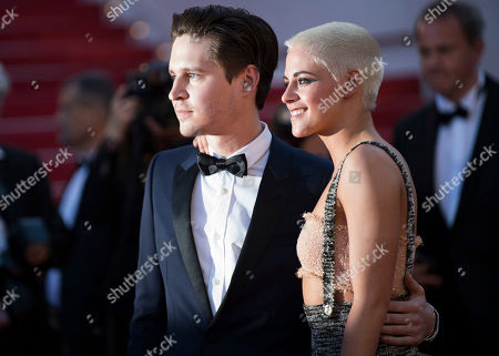 Josh Kaye, left, and Kristen Stewart pose for photographers upon arrival at the screening of the film 120 Beats Per Minute at the 70th international film festival, Cannes, southern France