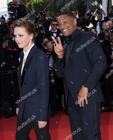 Jury members Maren Ade, left and Will Smith pose for photographers upon arrival at the 70th Anniversary of the film festival, Cannes, southern France