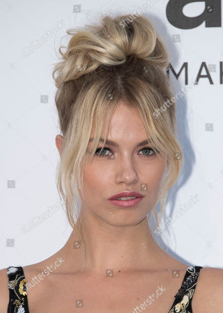 Hana Jirickova poses for photographers upon arrival at the amfAR charity gala during the Cannes 70th international film festival, Cap d'Antibes, southern France