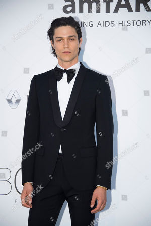 Will Peltz poses for photographers upon arrival at the amfAR charity gala during the Cannes 70th international film festival, Cap d'Antibes, southern France