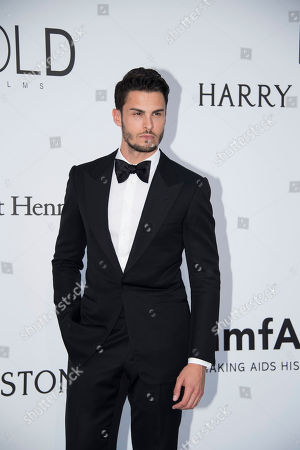 Baptiste Giabiconi poses for photographers upon arrival at the amfAR charity gala during the Cannes 70th international film festival, Cap d'Antibes, southern France
