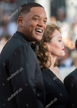 Will Smith, left, and Maren Ade pose for photographers upon arrival at the award ceremony at the 70th international film festival, Cannes, southern France