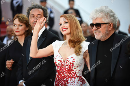 Jury members Maren Ade, from left, Paolo Sorrentino, Jessica Chastain and Pedro Almodovar pose for photographers upon arrival at the award ceremony at the 70th international film festival, Cannes, southern France