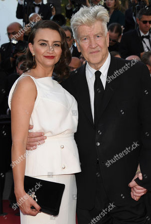 Director David Lynch, right, and Emily Stofle pose for photographers upon arrival at the award ceremony at the 70th international film festival, Cannes, southern France