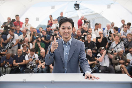 Actor Ryuhei Matsuda poses for photographers during the photo call for the film Before We Vanish at the 70th international film festival, Cannes, southern France, Sunday, May 21