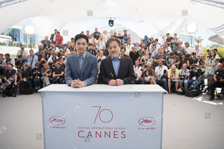 Actor Ryuhei Matsuda and director Kiyoshi Kurosawa pose for photographers during the photo call for the film Before We Vanish at the 70th international film festival, Cannes, southern France, Sunday, May 21