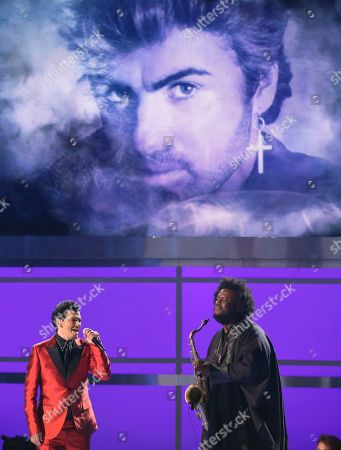 "Stock Picture of Kamasi Washington, right, and El DeBarge perform ""Careless Whisper"" as a picture of George Michael appears on screen during an in memoriam tribute at the BET Awards at the Microsoft Theater, in Los Angeles"