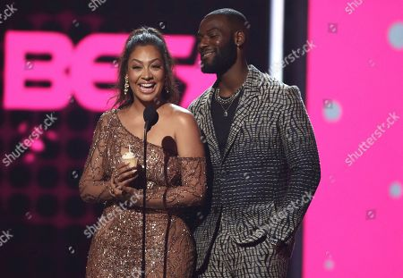 La La Anthony, left, and Kofi Siriboe present the Dr. Bobby Jones best gospel/inspirational award at the BET Awards at the Microsoft Theater, in Los Angeles