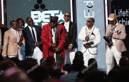 RiRicky Bell, from left, Johnny Gill, Bobby Brown, Ronnie DeVoe, Michael Bivins and Ralph Tresvant, of New Edition, accept the lifetime achievement award at the BET Awards at the Microsoft Theater, in Los Angeles