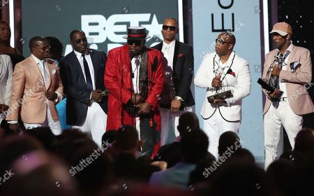 Ricky Bell, from left, Johnny Gill, Bobby Brown, Ronnie DeVoe, Michael Bivins and Ralph Tresvant, of New Edition, accept the lifetime achievement award at the BET Awards at the Microsoft Theater, in Los Angeles