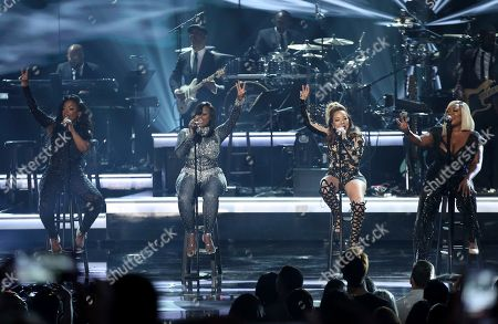 Kandi Burruss, from left, Tamika Scott, Tameka Cottle, and LaTocha Scott of Xscape perform at the BET Awards at the Microsoft Theater, in Los Angeles