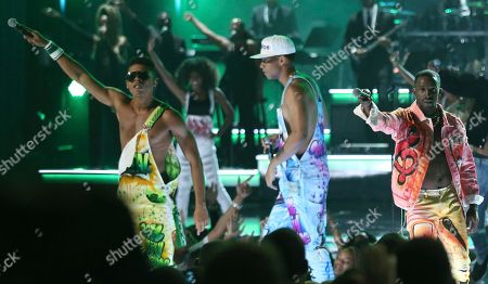 Bryshere Y. Gray, from left, Keith Powers, and Elijah Kelley from the cast of The New Edition Story perform at the BET Awards at the Microsoft Theater, in Los Angeles
