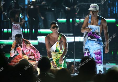 Elijah Kelley, from left, Bryshere Y. Gray, and Keith Powers from the cast of The New Edition Story perform at the BET Awards at the Microsoft Theater, in Los Angeles