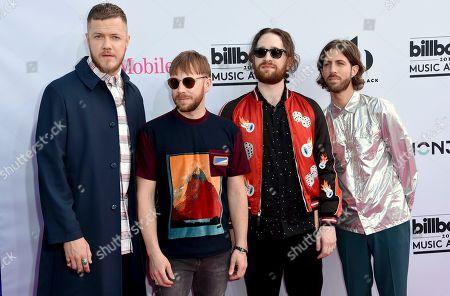 Dan Reynolds, from left, Ben McKee, Daniel Platzman and Daniel Wayne Sermon, of Imagine Dragons, arrive at the Billboard Music Awards at the T-Mobile Arena, in Las Vegas