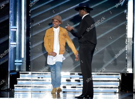 """Christopher Jordan Wallace, son of Notorious B.I.G., left, and Sean """"Diddy"""" Combs present a tribute to Notorious B.I.G. at the Billboard Music Awards at the T-Mobile Arena, in Las Vegas"""