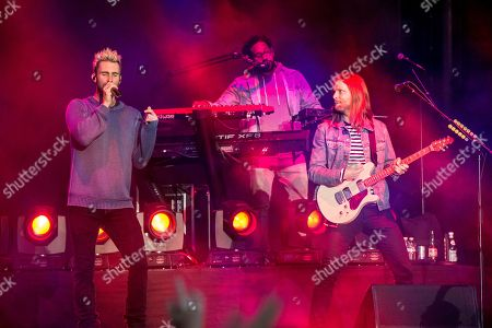 Adam Levine, from left, PJ Morton and James Valentine of Maroon 5 perform at BottleRock Napa Valley Music Festival at Napa Valley Expo, in Napa, Calif