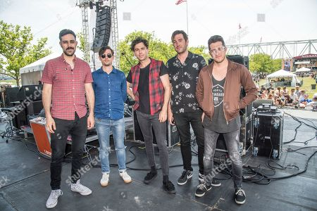 Nick Dika, from left, Mike DeAngelis, Max Kerman, Tim Oxford and Anthony Carone of the Arkells pose at the Bunbury Music Festival, in Cincinnati