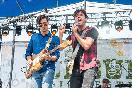Mike DeAngelis, left, and Max Kerman of the Arkells performs at the Bunbury Music Festival, in Cincinnati