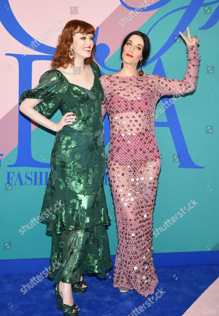 Karen Elson, left, and Sarah Sophie Flicker attend the CFDA Fashion Awards at the Hammerstein Ballroom, in New York
