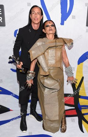 Rick Owens, left, poses in the press room holding the Geoffrey Beene lifetime achievement award with Michele Lamy at the CFDA Fashion Awards at the Hammerstein Ballroom, in New York