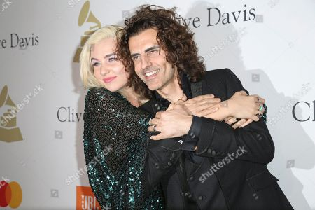Maty Noyes, left, and Stephan Moccio attend the Clive Davis and The Recording Academy Pre-Grammy Gala at The Beverly Hilton Hotel, in Beverly Hills, Calif