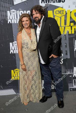 Andi Zack-Johnson, left, and Ken Johnson arrive at the CMT Music Awards at Music City Center, in Nashville, Tenn