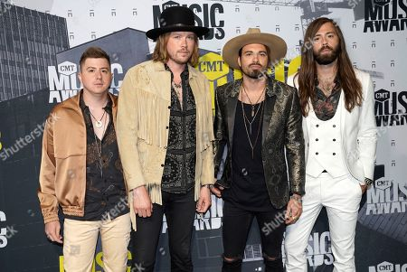 Bill Satcher, Michael Hobby, Zach Brown and Graham DeLoach of A Thousand Horses arrive at the CMT Music Awards at Music City Center, in Nashville, Tenn