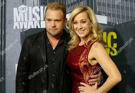 Kyle Jacobs, left, and Kellie Pickler arrive at the CMT Music Awards at Music City Center, in Nashville, Tenn