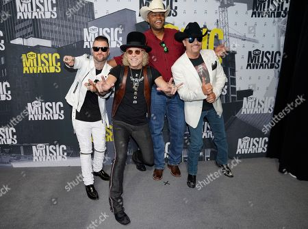 DJ Sinister, from left, Big Kenny, Cowboy Troy, and John Rich arrive at the CMT Music Awards at Music City Center, in Nashville, Tenn