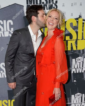 Josh Kelley, left, and Katherine Heigl arrive at the CMT Music Awards at Music City Center, in Nashville, Tenn