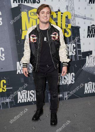Seth Ennis arrives at the CMT Music Awards at Music City Center, in Nashville, Tenn