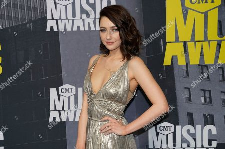 Natalie Dreyfuss arrives at the CMT Music Awards at Music City Center, in Nashville, Tenn