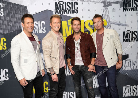 Scott Thomas, from left, Barry Knox, Matt Thomas, and Josh McSwain of Parmalee arrive at the CMT Music Awards at Music City Center, in Nashville, Tenn