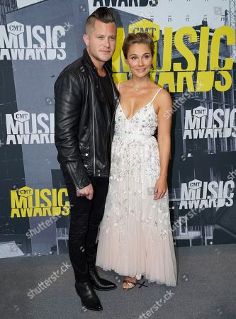 Brandon Robert Young, left, and Clare Bowen arrive at the CMT Music Awards at Music City Center, in Nashville, Tenn