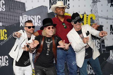 DJ Sinister, from left, John Rich, Cowboy Troy, and Big Kenny arrive at the CMT Music Awards at Music City Center, in Nashville, Tenn