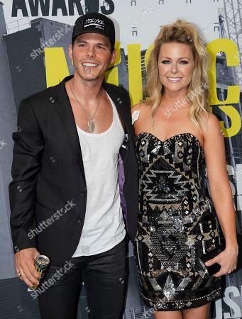 Granger Smith, left, and Amber Bartlett Smith arrive at the CMT Music Awards at Music City Center, in Nashville, Tenn