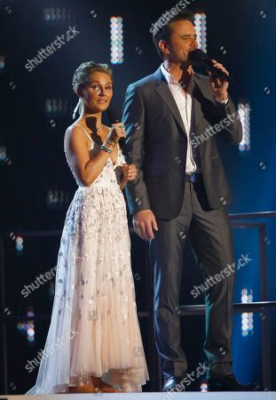Clare Bowen, left, and Charles Esten speak at the CMT Music Awards at Music City Center, in Nashville, Tenn