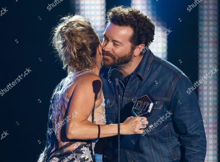 Stock Photo of Danny Masterson, right, congratulates Carrie Underwood as he presents her with the award for collaborative video of the year at the CMT Music Awards at Music City Center, in Nashville, Tenn