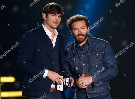 Ashton Kutcher, left, and Danny Masterson present the award for collaborative video of the year at the CMT Music Awards at Music City Center, in Nashville, Tenn