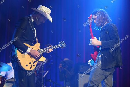 From left, artist Rayland Baxter and guitarist Nick Bockrath of rock band Cage the Elephant perform at the Dylan Fest at Ryman Auditorium on in Nashville, Tenn