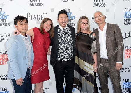 Ki Jin Kim, from left, Giulia Caruso, Andrew Ahn, Kelly Thomas, and David Ariniello arrive at the Film Independent Spirit Awards, in Santa Monica, Calif