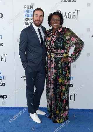 Nat Sanders, left, and Joi McMillon arrive at the Film Independent Spirit Awards, in Santa Monica, Calif